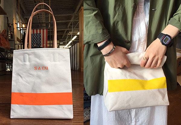9号生機の生地で作るカラーライン入りのトートバッグ。女性も気軽に持てる重さとデザインで、色もそれぞれオリジナルにオーダーできる。青、オレンジ、黄色、白など数色展開予定。レザーハンドルを内側に引き落とせば、ブラウンバッグや紙袋のように口をロールして持つことも可能